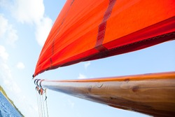 Traditional Wooden Boat, with red sail. Detail. Abstract