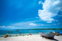 Traditional wooden boats parked at seashore white sand beach of Havelock Island, Andaman and Nicobar Islands Union Territory of India.