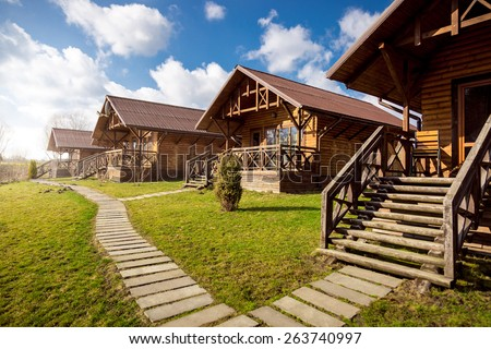 Traditional wooden cottages at sunny day in the countryside Сток-фото ©