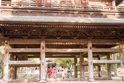 traditional wooden gate of Japanese temple, Kamakura, Japan. down-right corner's character means the expression of the gate