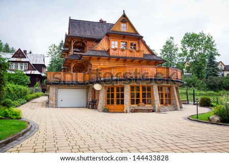 Traditional wooden house architecture in zakopane poland stock photo 144433828 shutterstock - Traditional polish houses wood mastership ...