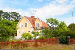 Traditional wooden house in south-eastern Sweden, painted in yellow