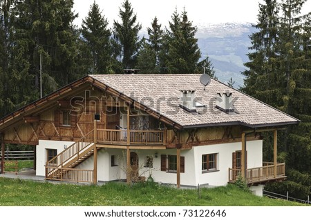 Traditional wooden House with Forest in Tyrol, Austria