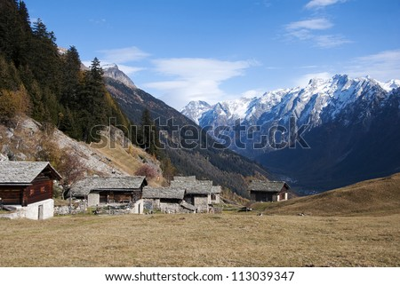 Traditional wooden hut in Alps mountains