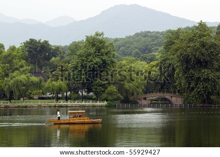 Traditional wooden row boat on famous West Lake, Hangzhou, China