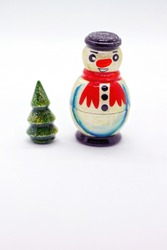 Traditional wooden russian toy. Nesting dolls - snowman and christmas tree. Popular souvenir from Russia.