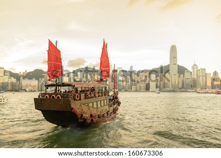 Traditional wooden sailboat / tourist junk sailing in Victoria Harbour during sunset ,Hong Kong