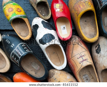 traditional wooden shoes in all sizes and colors hanging on a wall
