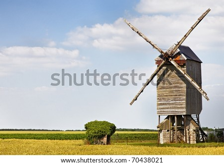 Traditional wooden windmill in France in the Eure &Loir Valley region.This is Saint-Thomas mill.