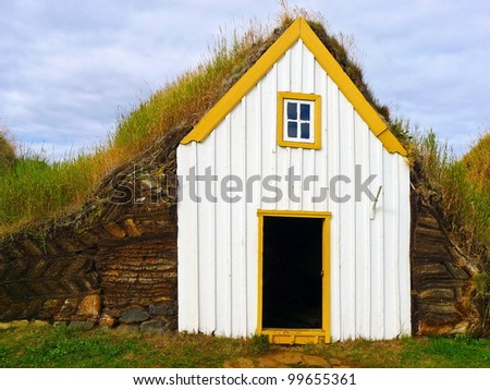 Traditional Yellow Iceland turfed roof house with green grass