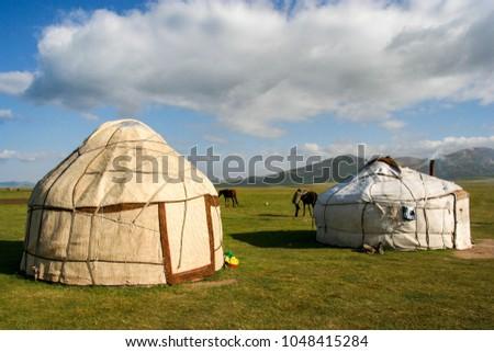 Traditional yurts at Song Kol Lake in Kyrgyzstan #1048415284
