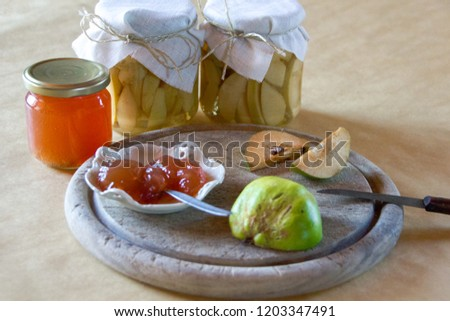 Traditionally canned quinces and home made quince marmelade to preserve them and to consume them later. Delicious and organic. Concept of conservation.conservation. Selective focus #1203347491