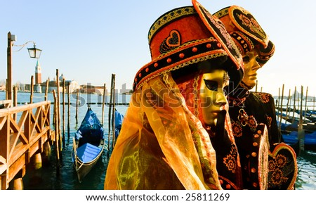 Traditionally dressed Venice carnival couples in Piazza San Marco, Italy