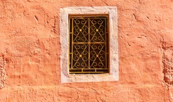 tradititional arabian style window in oldtown kasbah wall, Morocco