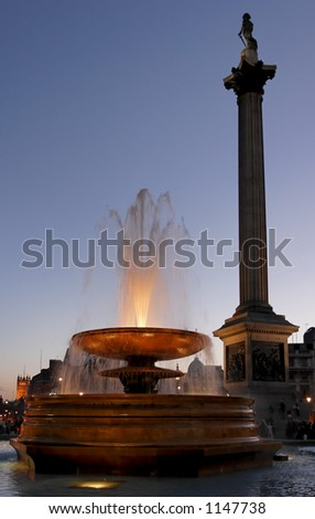 Trafalgar square at night with Nelson\'s Column and illuminated fountain