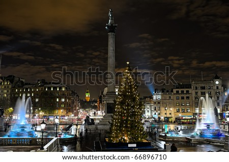 Trafalgar Square, London, England, UK, at night, in winter, with Norwegian Christmas tree.
