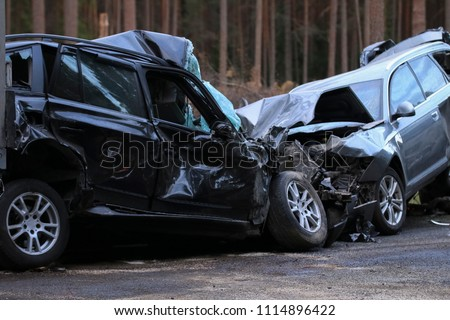 Traffic Accident Resulting in a Crushed Cars #1114896422