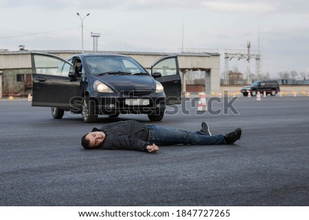 Photo of  Traffic accident with fatal outcome. A man was hit by a car and killed. A car hit a man. Excess of speed. Loss of consciousness