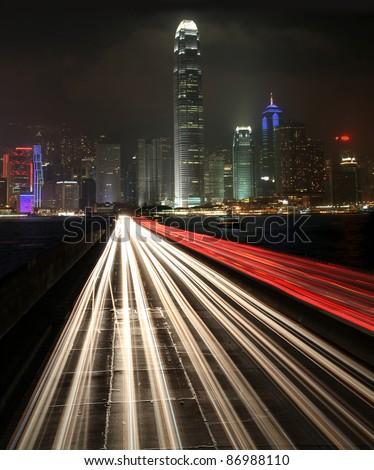 Traffic at night in urban city - stock photo