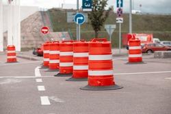 traffic barrier barrels in the parking lot