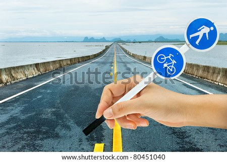 traffic bicycle sign in woman hand on road