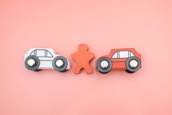 Traffic car toy accident and insurance concept on pink background. Agent examines and reports damage vehicle collide broken on the road. Investigation driver indemnity claim transportation. Top view