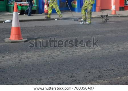 traffic cone on empty road #780050407