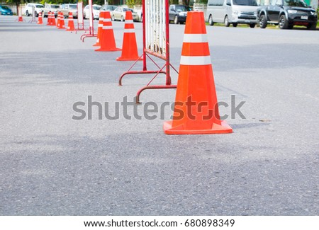 Traffic cone row old orange and swath white stripes on the road with copy space #680898349