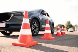 Traffic cones near car outdoors. Driving school exam