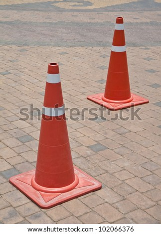 Traffic cones on the floor of the brick block.