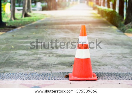 Traffic cones placed in the street #595539866