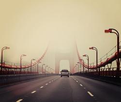 Traffic crossing a foggy Golden Gate Bridge in San Francisco