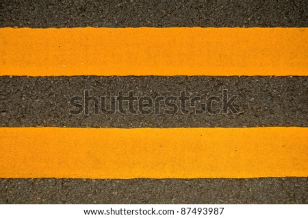 Traffic Image Of Double Yellow Lines On A Road - stock photo