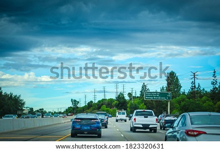 Traffic in a freeway on a cloudy day in California, USA stock photo