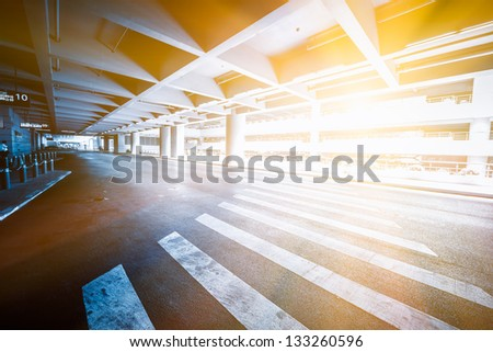 traffic in car park with blue toned in shanghai airport china. - stock photo