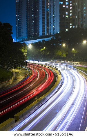 traffic in city at night in hong kong.
