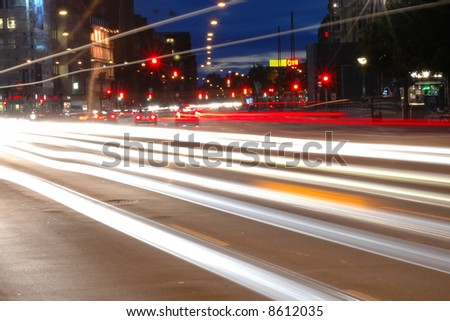 Traffic in the city by night - stock photo