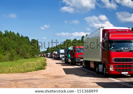Traffic jam congestion. Trucks in a row.