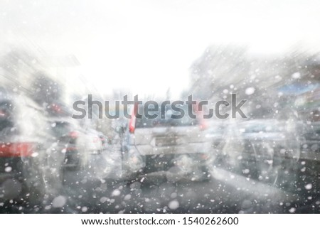 Traffic jam from cars in the city. Winter streets at rush hour. stock photo