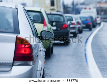 Traffic jam in flooded highway cause rain. - stock photo