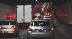 Traffic jam in urban tunnel vehicles in row