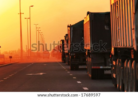 Traffic Jam of Heavy Trucks in Sunset