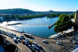 Traffic jam on bridge, Vltava river in Prague, Czech Republic. Concept of cars and road safety.