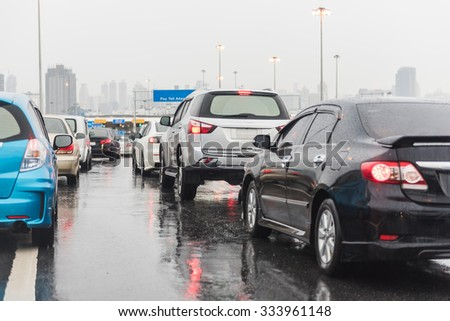 traffic jam on express way in raining day with many cars