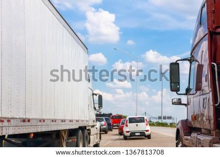 Traffic jam on highway, stuck between trucks #1367813708