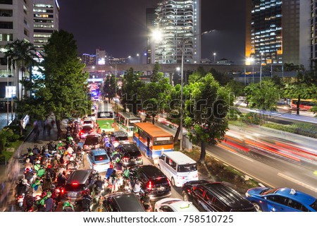 Traffic jam on the chaotic road in the Central Business district of Jakarta along the Sudirman avenue during rush hour in Indonesia capital city.
