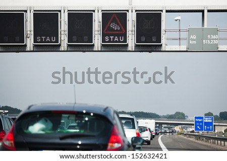 traffic jam signs over a traffic jam of a German autobahn