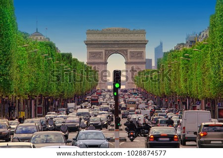 traffic jam with cars in Paris city, France. view of Arc de Triomphe and Champs - Elysees boulevard