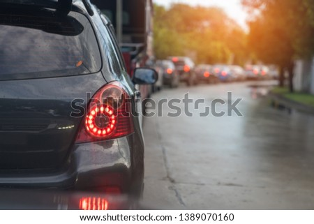 traffic jam with row of cars during raining, rush hour #1389070160