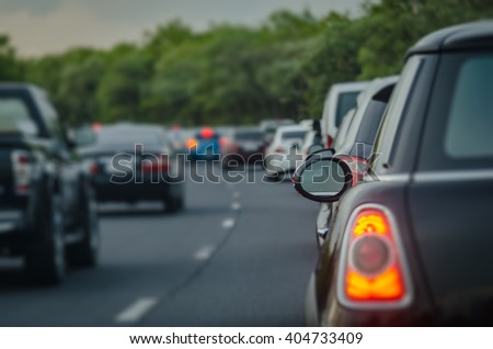 traffic jam with row of cars on express way during rush hour,  before night, selective focus as rear window